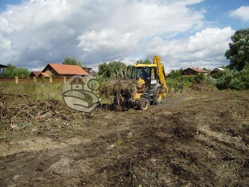 Уборка и расчистка участка тяжелой техникой