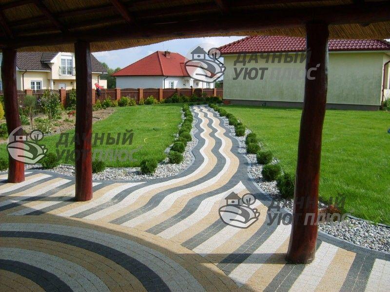 Мощение тротураной плиткой площадки